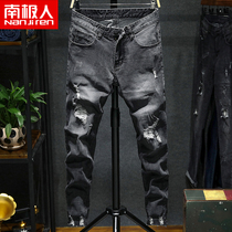 Antarctic autumn new hole jeans men slim feet pants youth beggars pants male Korean version of the trend