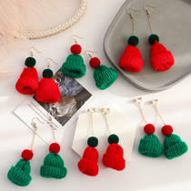 Autumn and winter cute plush knit hit color Christmas hat earrings female no ear hole ear clip net red personality earrings earrings